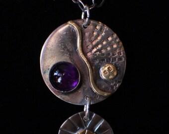 Handmade, mixed metal pendant with amethyst