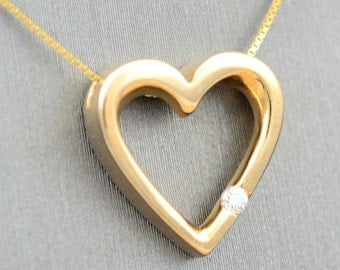 14 karat yellow gold heart with single diamond