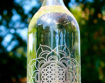 32oz. Flotus design etched glass water bottle with swing top. Eco friendly, reusable and made by hand.