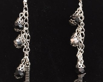 Earrings Silver Guitar Skull Charm with Silver Chain, Silver Fish Hooks and Black & Silver Crystal Beads.