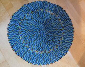 Handmade round crochet tablecloth