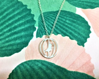 Silver bird in a cage pendant necklace