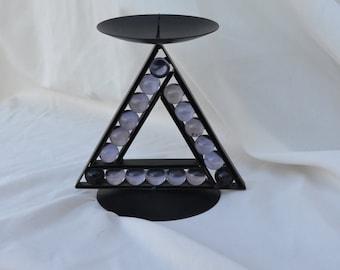 Illuminati candle holder