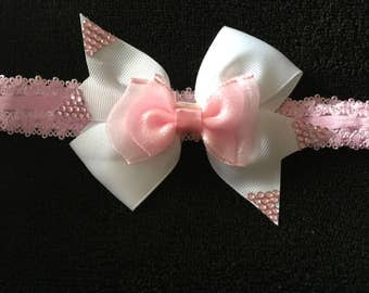 A Beautiful White Hair, With A Touch Of Pink, On An Elastic Headband.