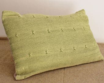 Green pillow in cotton in the back with buttons