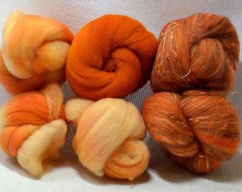 NEW! Tangerine Gradient Set With Bricolage Studios Tonal Tweedy Batt Bumps - A great combination of fiber to enhance your creativity