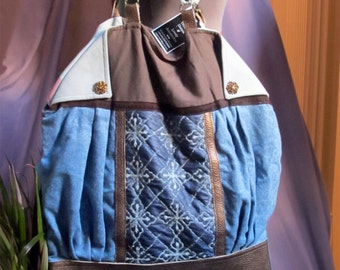 Tote handmade bag, with flaps, on leather and wool fabric A classic winter style, snow seasson,