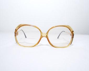 70s oversized glasses frames. CHRISTIAN DIOR frames. golden honey eyeglasses