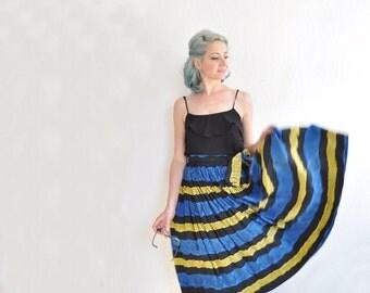 mid century tribal full skirt . 1950 blue yellow batik print midi .extra small.small.xs