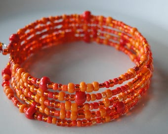 Orange beaded coil wrap bracelet, memory wire