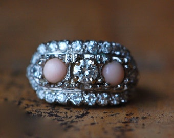 Vintage 1950s platinum, coral, and diamond pavé cocktail ring