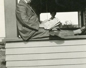 Relaxing READING The NEWSPAPER On The Porch Railing Photo circa 1920s