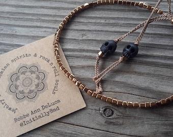 Bronze Cubes Silk Adjustable Bracelet with Carved Skulls