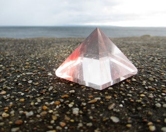 Small rose color and clear glass pyramid - special and carries good energy
