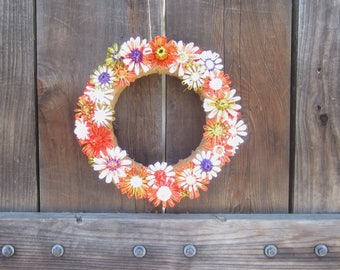 Edith 12 inch burlap wreath with bright orange and shades of gold green, white and purple flowers woven in vintage Swistraw by Ruby Buffalo.