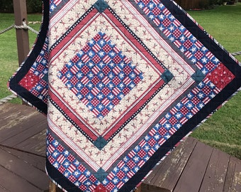 "Deep Red, Denim Blue, Navy and Americana Are Altogether In This 43""X 43"" Quilt or Table Topper"