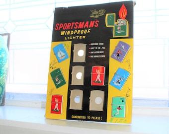 Sportman's Lighter Display Board & 8 Penguin Lighters Vintage 1960s
