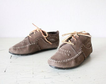 lace up moccasin boots / 7 w