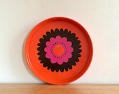 Seventies orange round metal Brabantia serving tray with Patrice floral decor in pink and black