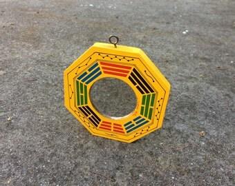 Auspicious Reflector -- Octagonal feng shui mirror made from wood