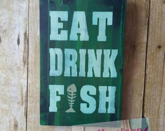 wooden sign EAT DRINK FISH