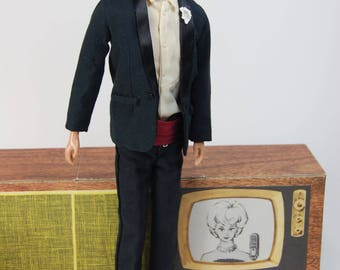 Vintage Ken black flocked hair first issue Mattel doll wearing number 787 Tuxedo black suit cummerbund shoes