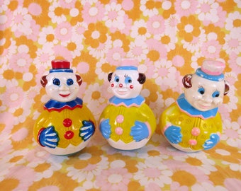 Vintage trio of clown baby rolly plastic rattles
