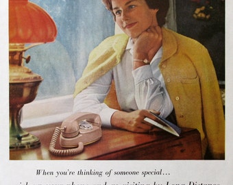 1961 AT&T Bell Telephone System Ad - Woman Waiting for a Long Distance Phone Call