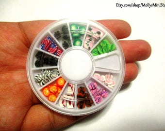 Handmade polymer clay 60 assorted cane slices in nail art wheel / carousel wheel container