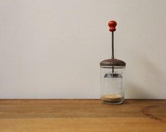 Vintage kitchen red handled chopping jar