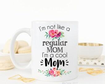 I'm not like a regular mom, i'm a cool mom.Mean girls.Cool mom.Mom coffee mug.Funny coffee mug.Momlife.Mugs with sayings.Coffee mug.Mug.
