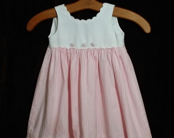 An dorable little girl, late 90's pink and white  dress.