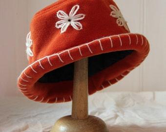 Rust orange fleece cloche daisy hat