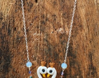 Gliding swans necklace