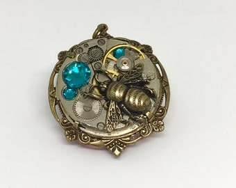Valentine gift, Steampunk bumblebee, teal crystal, with old watch parts and cogs and wheels,vintage watch parts, cogs, long lake studio,