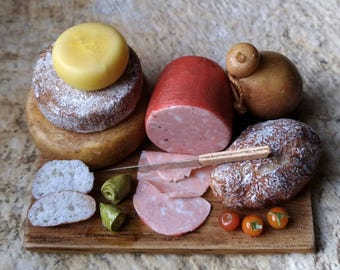 Cutting board with mortadella and cheese
