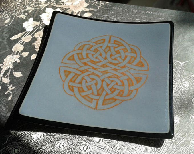 Grey fused glass dish with celtic knotwork design.