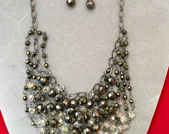 Necklace and earring set that drapes the neck in luxurious faceted polished crystals. The beads are 8 & 6mm together with gun metal wire.