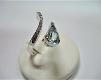 drop cut aquamarine ring and diamonds made in white gold