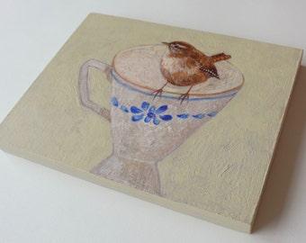 Wren on teacup