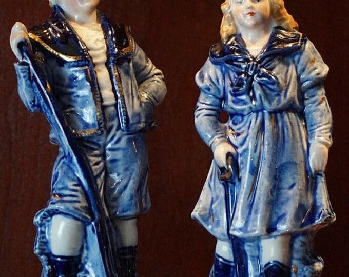 Porcelain Oarsmen Figurines
