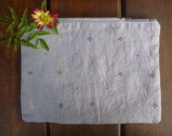 Pure linen zippered pouch with a diamond pattern cross stitched on the front.