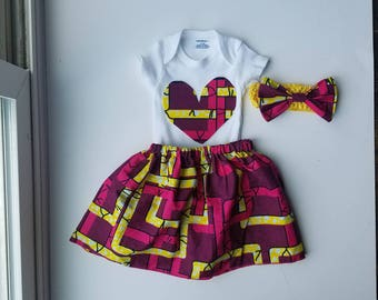 Ankara Onesie, skirt and hair bow.
