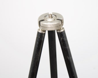 Antique metal tripod with expanding legs.