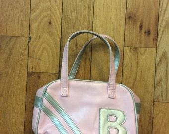 pink and grey handbag