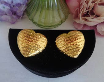 """Vintage New With Tags Givenchy Puffy Heart Earrings. The Earrings Measure 1.75"""" wide and 1 & 3/8ths of an inch Tall."""