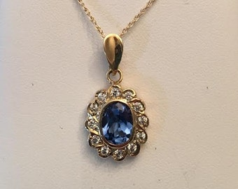 """14k yellow gold Oval Created Blue Spinel and Clear CZ scalloped pendant, 18"""""""