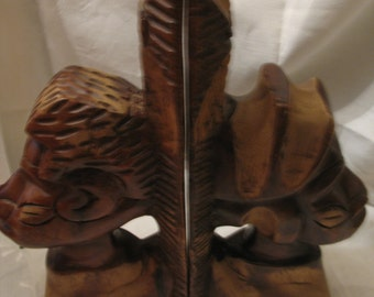 Greenhouse - carved wooden African art books. Book ends.