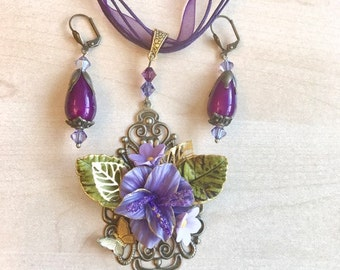 Purple, bronze adornment and old gold, cold porcelain and Swarovski crystal flower