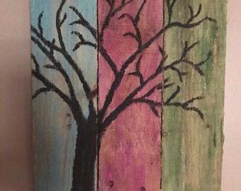 Painted tree on pallet wood